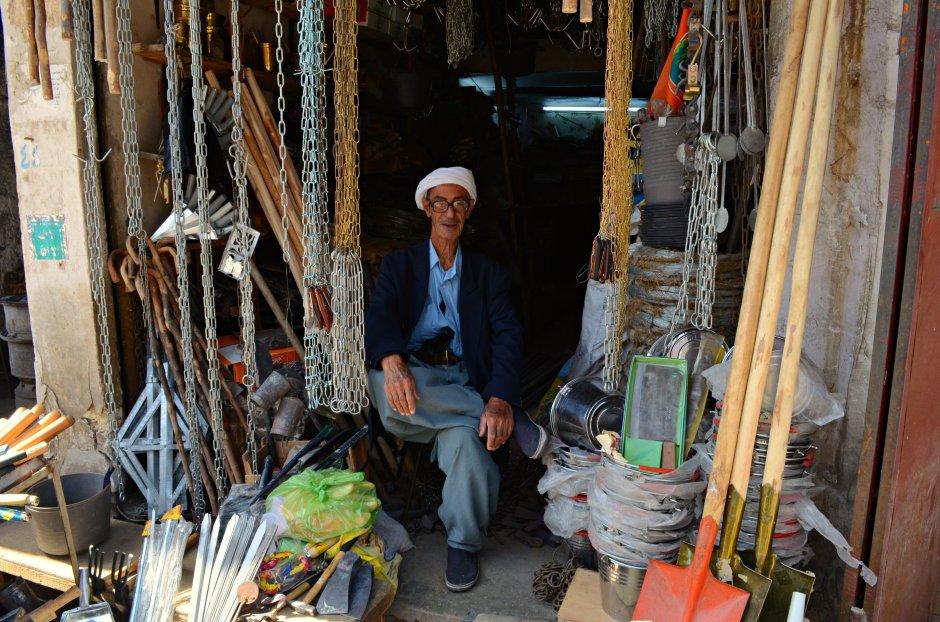 An old man in his 80s in his hardware store in Kirkuk, by Karwan Bashan