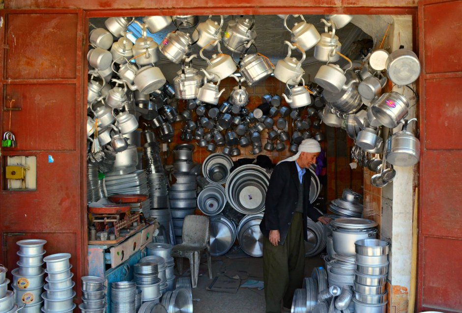 An old man in his 70s in his kitchen shop in Kirkuk, by Karwan Bashan