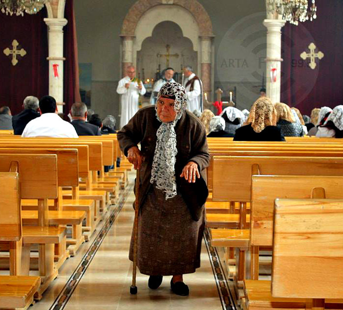 An old woman in Church during last Easter in Hasaka, Syria via Arta FM