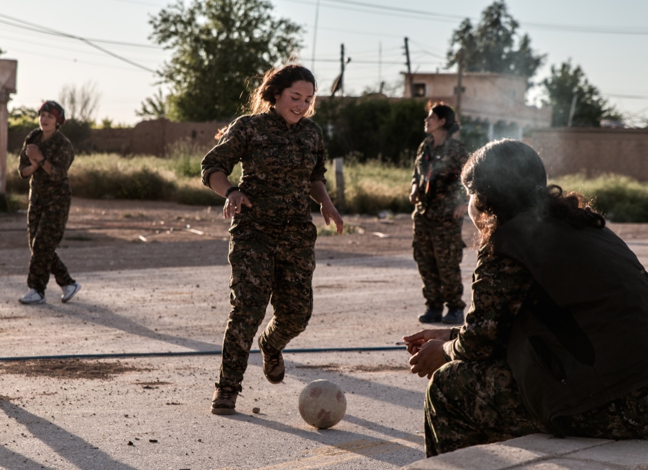 Women fighters take advantage of a lull in the fighting on the frontline to relax.