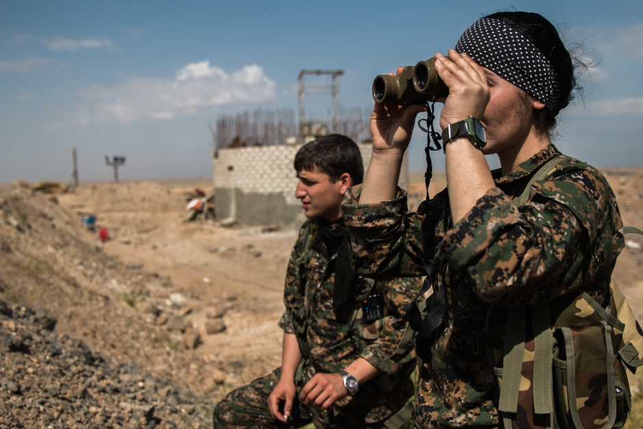 Commander Malsa surveys the terrain between Kurdish and ISIS lines as troops prepare to move forward.