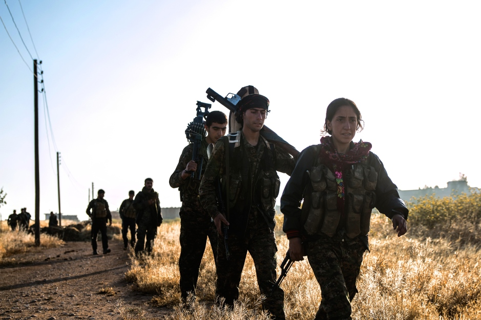 A YPJ commander leads her troops into battle at the start of the May offensive in Hasakah to try and retake the Abdul Aziz mountains. The offensive, greatly aided by coalition airstrikes, was initially successful, however ISIS have already begun counter-attacks to push back towards the city