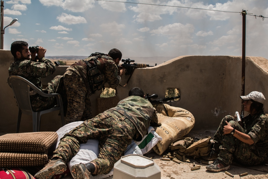Sniper teams provide harassing fire onto ISIS positions as ground troops advance during the offensive