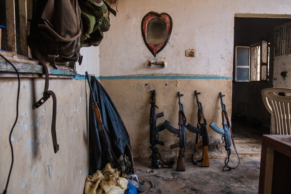 Weapons are left outside whilst fighters prepare lunch. Neither the YPJ nor the YPG are particularly well equipped, the Kalashnikov assault rifle being the weapon of choice in most cases, although Russian light machine guns, mortars, and home-made sniper rifles are also made available to some units