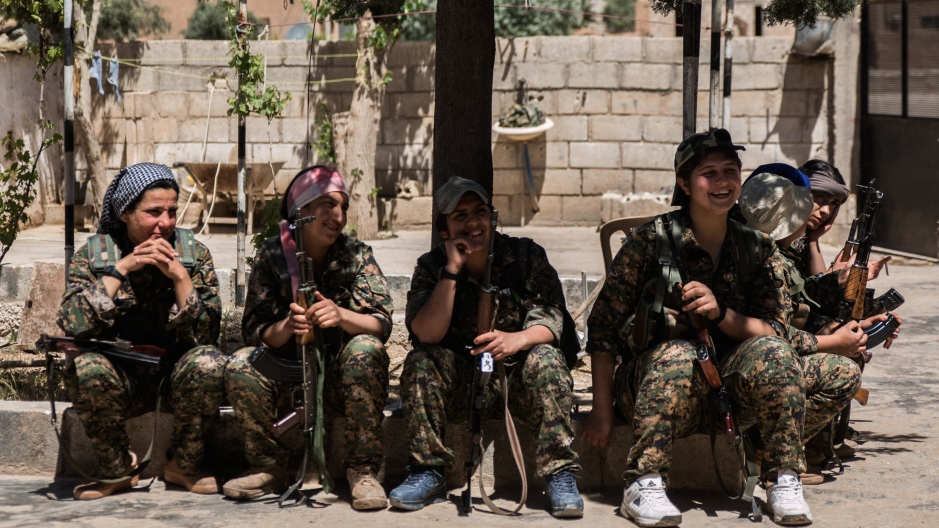 YPJ fighters share a joke in between training for an upcoming assault on an ISIS-held village.