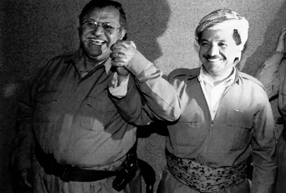 The two main Kurdish guerrilla leaders, Jalal Talabani, left, and Massoud Barzani, clasp hands in a sign of unity in Salahudin, Northern Iraq, May 22, 1992. Moderate leader Barzani was reported ahead today in the tabulating of votes from Iraqi Kurds first free election for a leader as he continued talks with his chief rival, Talabani, on sharing power. (AP Photo/Burhan Ozbilici)